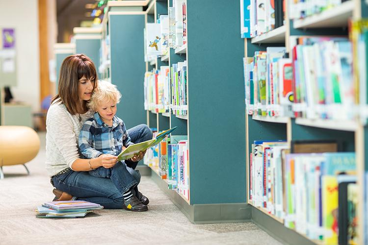 Mom and child browsing books